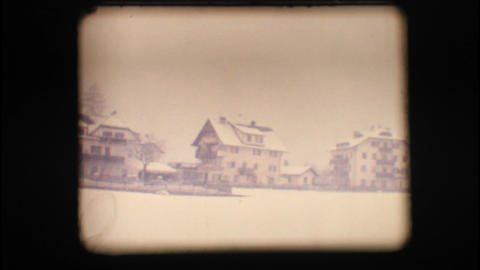 Vintage 8mm. Snowy neighbourhood Stock Video Footage