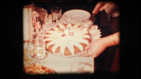 Vintage 8mm. Woman cutting cake Footage