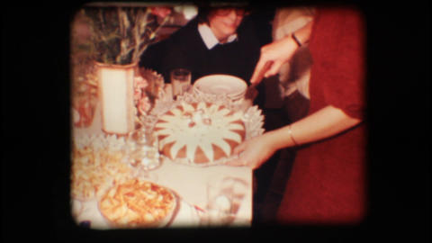 Vintage 8mm. Woman cutting cake Stock Video Footage