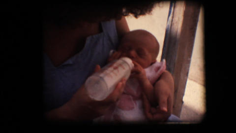 Vintage 8mm. New born baby drinking milk from the  Footage