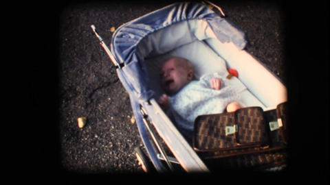 Vintage 8mm. Small baby crying in his carriage Stock Video Footage