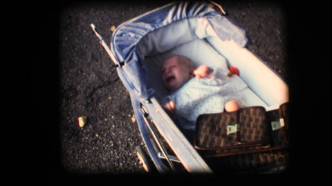 Vintage 8mm. Small baby crying in his carriage Footage