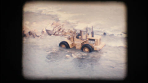 Vintage 8mm. Tractor working in the Adige river Stock Video Footage