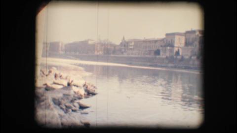 Vintage 8mm. Adige river and buildings Stock Video Footage