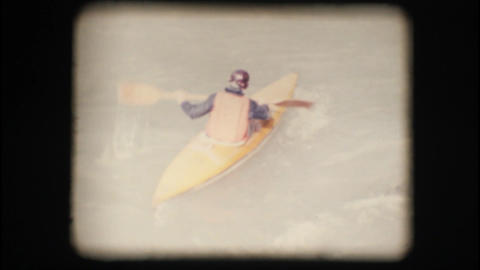 Vintage 8mm. Man kayaking against the current Stock Video Footage