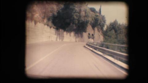Vintage 8mm. Camera car following a car Footage