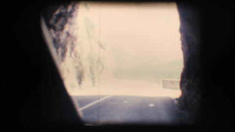 Vintage 8mm. Camera car driving through a country Stock Video Footage