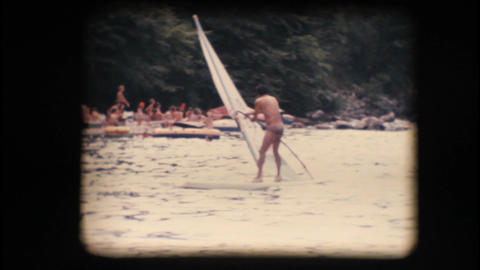 Vintage 8mm. Windsurfer preparing his sail Stock Video Footage
