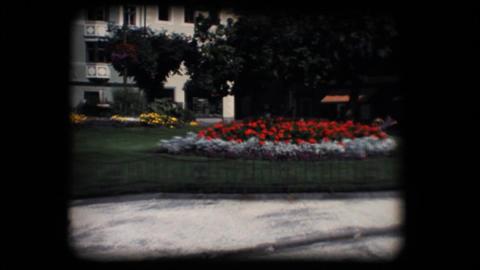 Vintage 8mm. Public flower garden Footage