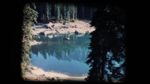 Vintage 8mm. Calm mirroring lake Footage