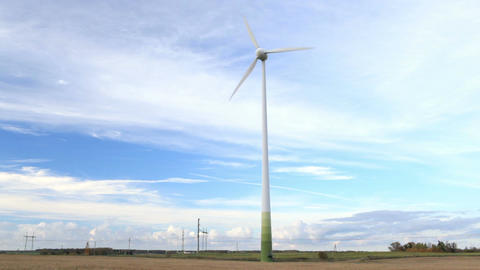 Wind Turbine In The Field. NTSC Version. PAL Version Is Also Available. stock footage