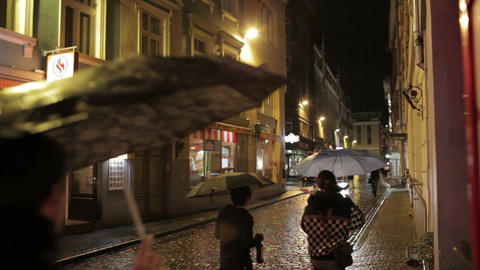 People walking along street bars and restaurants in the... Stock Video Footage