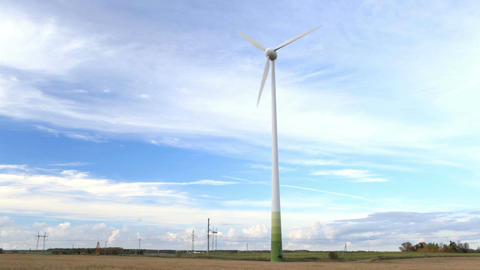 Wind Turbine In The Field. PAL Version. NTSC Version Is Also Available. stock footage