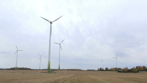 Many wind turbines in the field. Go green! Stock Video Footage