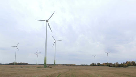 Many wind turbines in the field. Go green! Footage