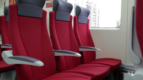 Red chairs in a modern high speed train Stock Video Footage