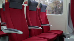 Red chairs in a modern high speed train Footage