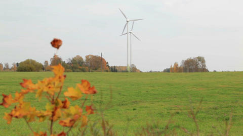 Two wind turbines in the field Stock Video Footage