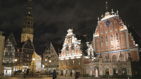 Beautiful old architecture of the central square of Riga. Night view with illuminated buildings and