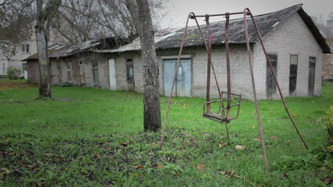 The broken child's swing. Unhappy childhood concept Stock Video Footage