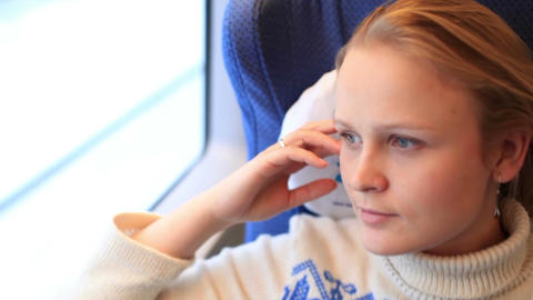 Young girl is travelling by a high-speed train Stock Video Footage
