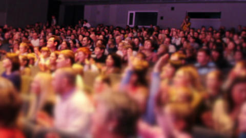 The anonymous audience applauded after the premiere. Tilt shift effect, no visible faces Footage