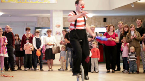 Clown riding a unicycle in Akvamarine circus. A unicycle is a human-powered, single-track vehicle wi Footage