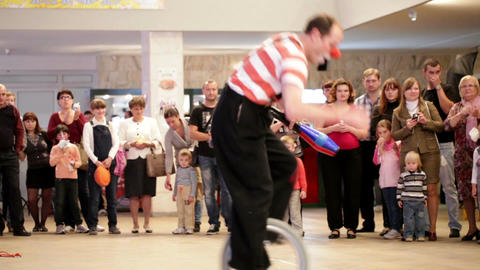 Clown riding a unicycle in Akvamarine circus. A unicycle... Stock Video Footage