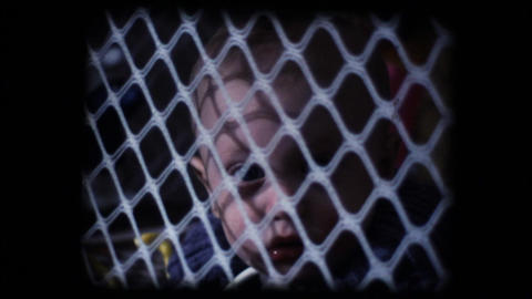 Vintage 8mm. Little baby inside play pen Stock Video Footage