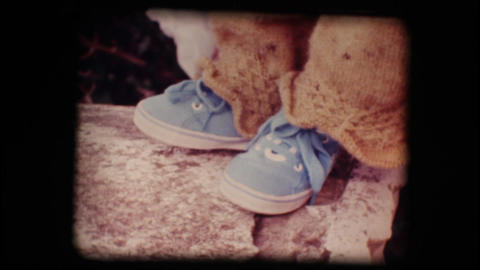 Vintage 8mm. Shoes of a little baby Stock Video Footage