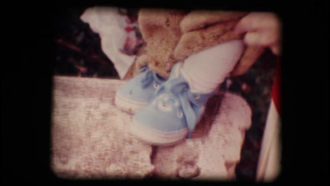 Vintage 8mm. Shoes of a little baby Footage
