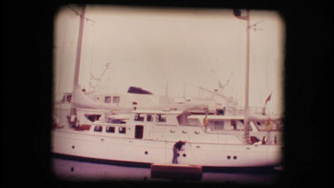 Vintage 8mm. Docked sail boat Footage