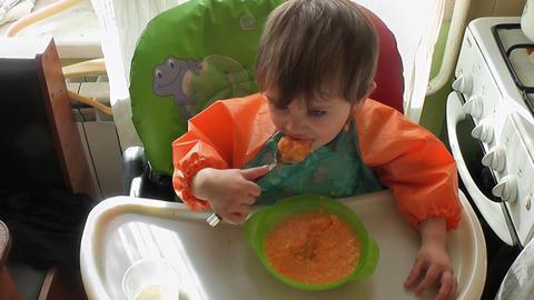 boy eats 02 Stock Video Footage