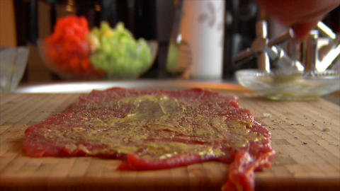 coat mustard on beef roulade 10851 Stock Video Footage