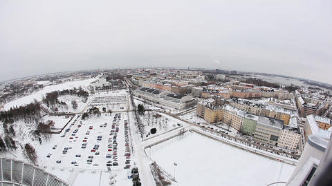 Aerial Helsinki view at winter time, city covered with snow, car parking, houses Footage