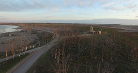 Aerial Drone scene of abandoned Slaughterhouse at sunset, lonely, surrounded by  Footage