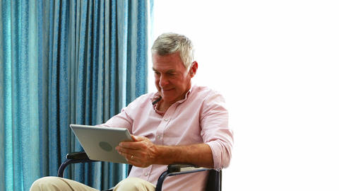 Patient is playing on his tablet Live Action