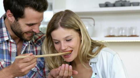 Boyfriend making taste the meal Stock Video Footage