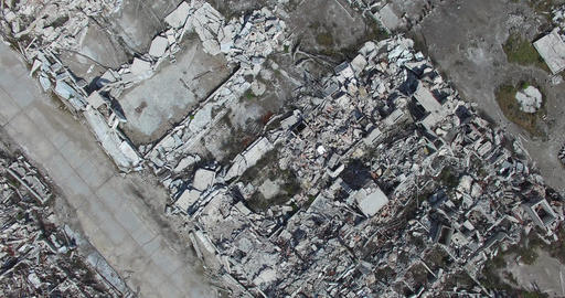 Top aerial view of destroyed town. Cityscape. Demolished neighbourhood, houses t Footage