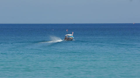 Longtail motor boat in ocean Footage