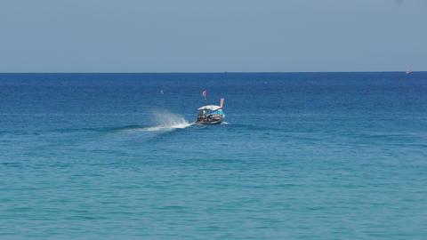 Longtail motor boat in ocean Footage