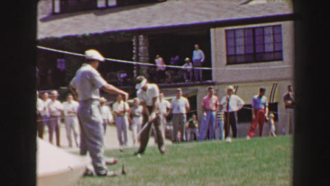 1968: Professional Golf Tournament Tees Off On 1st Hole At Clubhouse, Crowd Watc stock footage