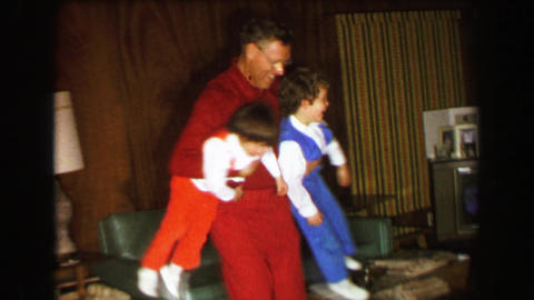 1957: Grandpa's wild spinning dizzy hurricane child care playtime Footage