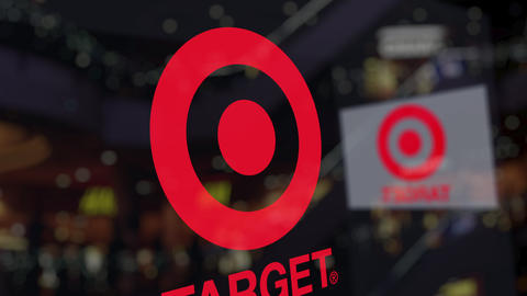 Target Corporation logo on the glass against blurred business center. Editorial Footage