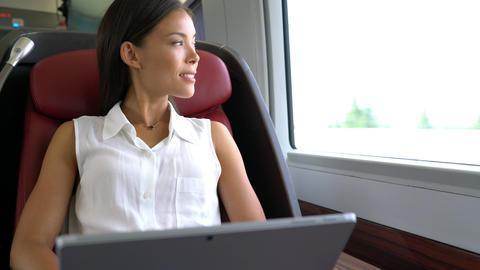 Businesswoman working on laptop on train Footage