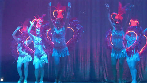 Girls with glowing hearts doing a sexy dance on stage converted Footage