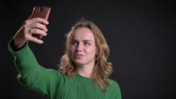 Closeup portrait of adult caucasian female having a video call on the phone and Footage