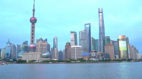 Phone photo on China travel in Asia Tourist taking phone photo of Bund Shanghai Live Action