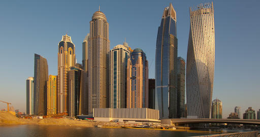 View from Promenade on Dubai Marina modern Towers from day to night. Time Lapse Footage