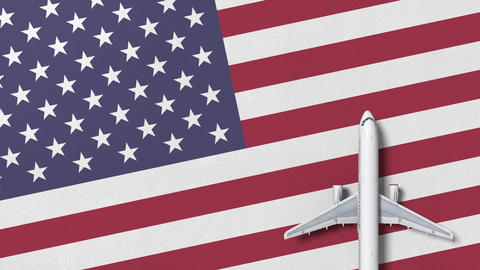 Top-down view of the airplane on the flag of the United States. Tourism related Footage